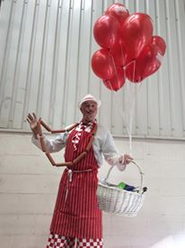 stilt walking butcher