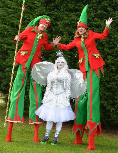 elves on stilts with a fiary