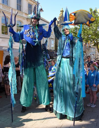 stilt walkers nautical regatta ocean theme