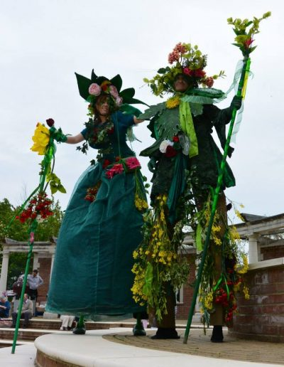 stilt walkers garden theme green man mother nature