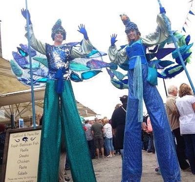 stilt walkers water birds blue ocean theme water theme