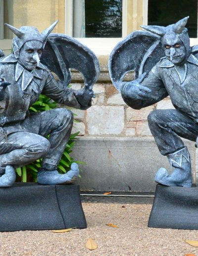 living statue gargoyles entertaining human statue