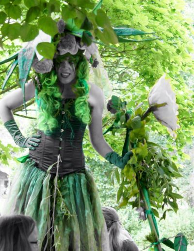 stilt walker floral garden theme